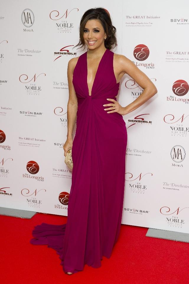 U.S actress Eva Longoria arrives for the Noble Gift Gala, at a central London venue, Saturday, Dec. 10, 2011. (AP Photo/Jonathan Short)