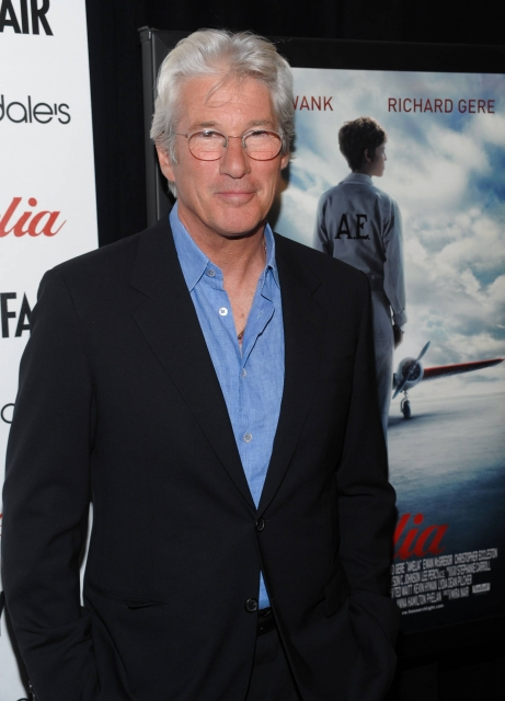"Actor Richard Gere attends the world premiere of ""Amelia"" at the Paris Theater in New York, Tuesday, Oct. 20, 2009. (AP Photo/Evan Agostini)"
