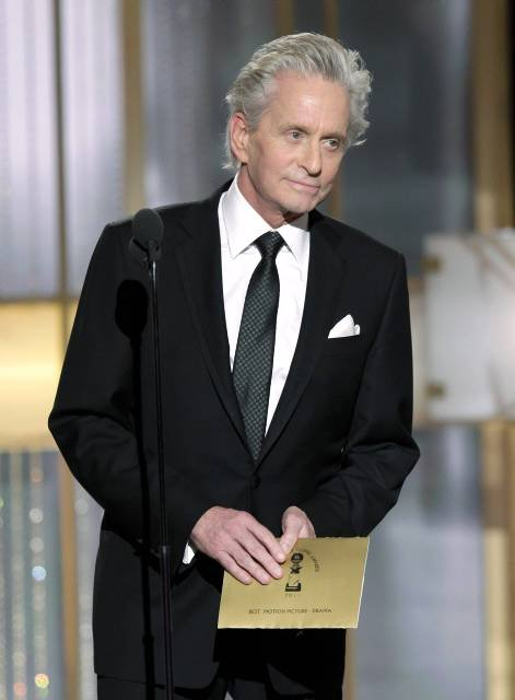 Actor Michael Douglas listens to a standing ovation as he comes on stage to present an award at the 68th annual Golden Globes Awards in Beverly Hills, California January 16, 2011.  REUTERS/Paul Drinkwater/NBC/Handout (UNITED STATES) NO SALES. NO ARCHIVES. FOR EDITORIAL USE ONLY. NOT FOR SALE FOR MARKETING OR ADVERTISING CAMPAIGNS. NO THIRD PARTY SALES. NOT FOR USE BY REUTERS THIRD PARTY DISTRIBUTORS.THIS IMAGE HAS BEEN SUPPLIED BY A THIRD PARTY. IT IS DISTRIBUTED, EXACTLY AS RECEIVED BY REUTERS, AS A SERVICE TO CLIENTS. SPECIFIC CLEARANCE REQUIRED FOR COMMERCIAL OR PROMOTIONAL USE. CONTACT YOUR NBCU REPRESENTATIVE FOR FURTHER INFORMATION