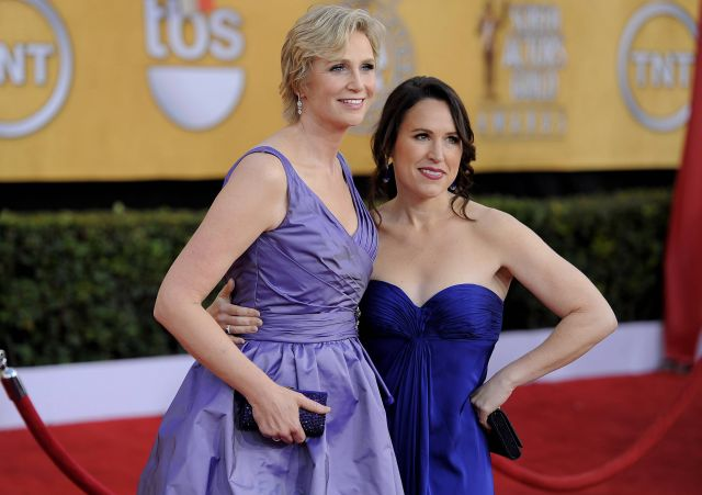 Jane Lynch, left, and Lara Embry arrive at the 17th Annual Screen Actors Guild Awards on Sunday, Jan. 30, 2011 in Los Angeles. (AP Photo/Chris Pizzello)