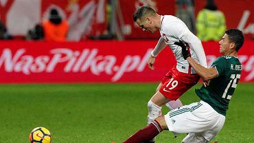 Piotr Zieliński i Hector Moreno w meczu Polska - Meksyk