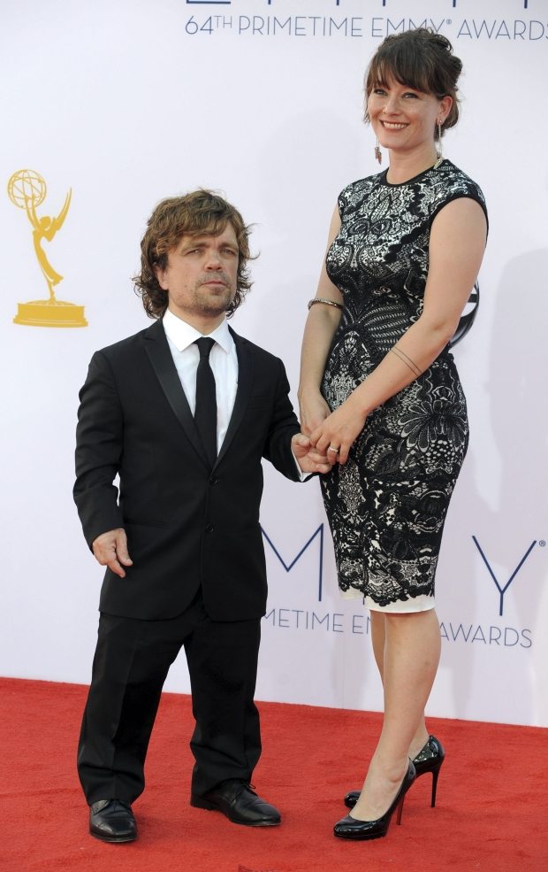 Actor Peter Dinklage, left and wife Erica Schmidt arrive at the 64th Primetime Emmy Awards at the Nokia Theatre on Sunday, Sept. 23, 2012, in Los Angeles.  (Photo by Jordan Strauss/Invision/AP)