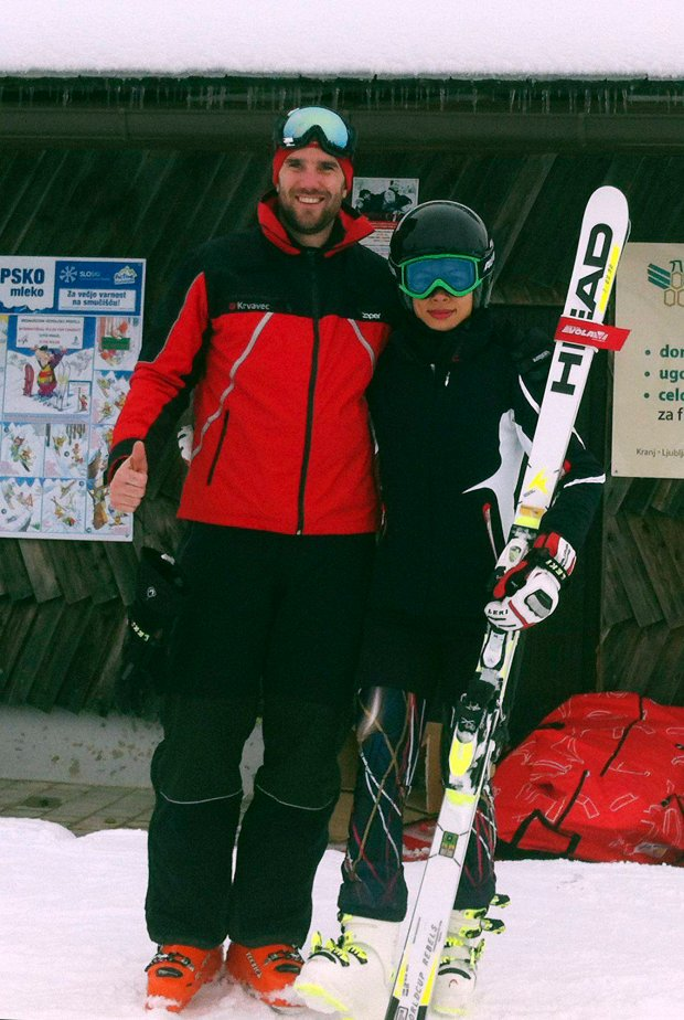 In this photo provided by RTC Krvavec skiing center in Slovenia, Vanessa-Mae, Singapore born British a classical-pop violinist, poses with Uros Zupan, deputy manager of the skiing center, in Krvavec, Slovenia, Thursday, Jan. 16, 2014. The International Ski Federation published rankings on Monday confirming the musician has met the qualifying criteria to compete at the Sochi Winter Olympics. Mae, an avid skier since childhood, has been competing as Vanessa Vanakorn, adopting her father's surname, and will ski for his country, Thailand. (AP Photo/RTC Krvavec)