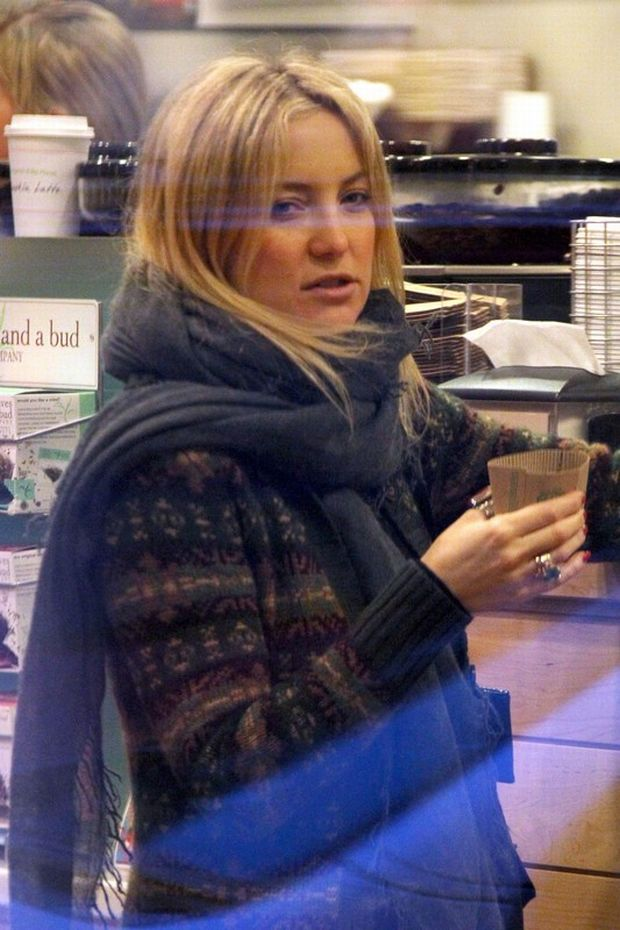 48712, ASPEN, COLORADO - Tuesday December 21, 2010. A barefaced Kate Hudson, wearing a large turquoise bracelet, grabs a late coffee to try and keep warm on a cold evening in Aspen. Hudson has recently been linked to Muse frontman Matt Bellamy. Photograph: Kevin Perkins/Pedro Andrade, ?