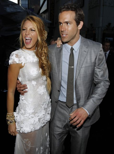 Cast member Ryan Reynolds, right, and Blake Lively pose together at the premiere of