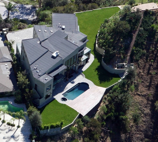 "MAVRIXONLINE.COM - DAILY MAIL ONLINE OUT - NO WEB USE UNLESS FEES AGREED - EXCLUSIVE!! - FILE PHOTO - It's reported that Rihanna has listed her Beverly Hills estate for sale with an asking price of $4.5 million. She paid $6.9 million for the home in 2009. It features 8 bedrooms in 10,000 square feet and includes 30-foot ceilings, a home theater, sauna and steam room. Reports go on to say that it may be difficult for Rihanna to sell the home as she has also filed a lawsuit against the former owner for allegedly lying to her about defects in the home prior to its sale. The lawsuit also includes the inspector, real estate agents involved with the sale and the engineers who worked on the house. According to the reports, Rihanna claims the woman said she was not aware of any major defects in the property, but actually knew of a number of problems with the home including waterproofing and construction defects and evidence of water intrusion allegedly from a balcony built higher than its adjacent interior flooring. The home was hit by a ""moderate rainstorm"" in January 2010 and water leaked into several rooms causing severe damage due to the defects. Beverly Hills, CA. 7th November, 2011.  ORIGINAL CAPTION AT - MX0230595.jpg  Fees must be agreed prior to publication.  Byline, credit, TV usage, web usage or linkback must read MAVRIXONLINE.COM.  Failure to byline correctly will incur double the agreed fee.  ."
