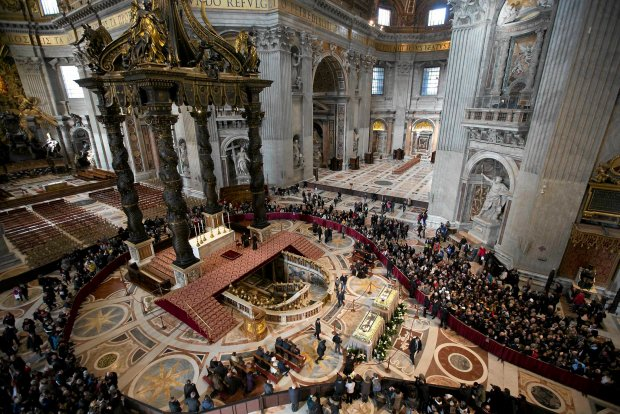 The box containing the corpses of Saint Pio da Pietralcina, left, and of Saint Leopoldo Mandic are displayed to faithful inside St. Peter's Basilica at the Vatican, Saturday, Feb. 6, 2016. Saint Pio is widely venerated in Italy and abroad. He is famous for bearing the stigmata, which are the marks of Christ, and was canonized by Pope John Paul II in 2002. He died on Sept. 23, 1968. (AP Photo/Alessandra Tarantino, Pool)