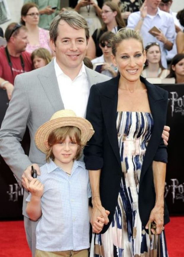 "Actors Matthew Broderick and Sarah Jessica Parker pose with their son James Wilke at the premiere of ""Harry Potter and the Deathly Hallows: Part 2"" at Avery Fisher Hall on Monday, July 11, 2011 in New York. (AP Photo/Evan Agostini)"