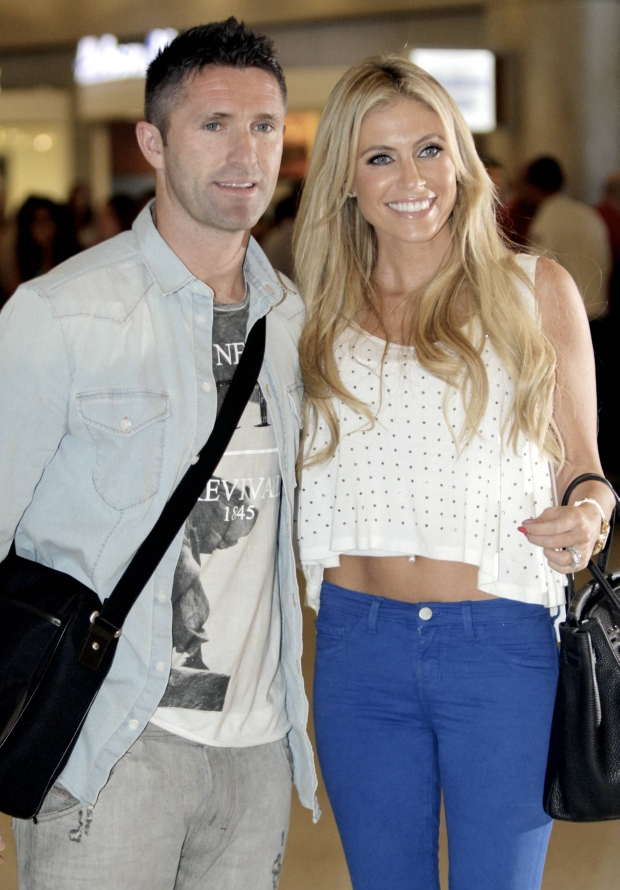 MAVRIXONLINE.COM - DAILY MAIL ONLINE OUT - LA Galaxy recently signed Ireland's Robbie Keane and his beautiful wife Claudine Keane arrive at LAX for the first time to begin his American soccer career along side  David Beckham, Landon Donovan and their teammates on the Los Angeles' MLS team.  Robbie is set to be introduced at The Home Depot Center on Friday and should make his debut on Saturday night when the LA Galaxy take on the rival San Jose Earthquakes.  18th August 2011.  Fees must be agreed for image use.  Byline, credit, TV usage, web usage or linkback must read MAVRIXONLINE.COM.  Failure to byline correctly will incur double the agreed fee.  .