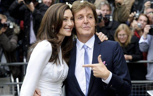 Former Beatle Paul McCartney and American heiress Nancy Shevell are seen after their wedding at Marylebone Town Hall, London, Sunday, Oct. 9, 2011. McCartney and Shevell were married on Sunday, emerging joyously from a 45-minute civil marriage ceremony to be showered with confetti from fans. (AP Photo/Jonathan Short)