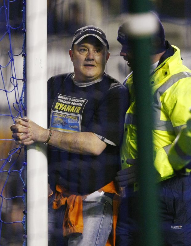 A man handcuffs himself to the goalpost during the English Premier League soccer match between Everton and Manchester City at Goodison Park, Liverpool, England, Tuesday, Jan. 31, 2012. (AP Photo/Tim Hales)