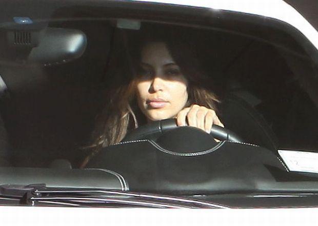 Kim Kardashian leaves the gym in her white Ferrari,  wearing no make up. January 31, 2012 X17online.com  *** Local Caption ***  Kim Kardashian