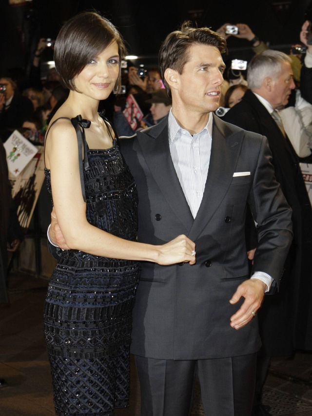 U.S actors Tom Cruise and wife Katie Kolmes arrive on the red carpet for the UK Premiere of Valkyrie, at a central London cinema, Wednesday, Jan. 21, 2009. (AP Photo/Joel Ryan)