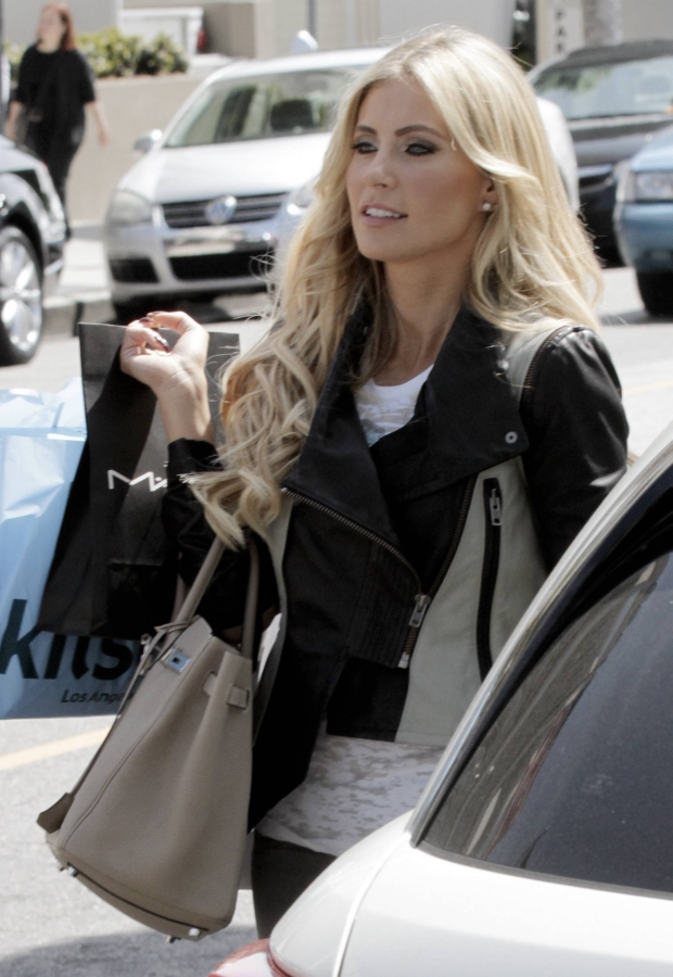 MAVRIXONLINE.COM - NO WEB USE UNLESS FEES AGREED - EXCLUSIVE!! L.A. Galaxy's Robbie Keane's wife Claudine Keane was spotted shopping on famed Robertson Blvd. The 28 year old former Miss Ireland contestant wore a black & grey patterned jacket, white top, grey figure flattering jeans and grey high heel boots. Los Angeles, CA. 24th March 2012.  Fees must be agreed prior to publication.  Byline, credit, TV usage, web usage or linkback must read MAVRIXONLINE.COM.  Failure to byline correctly will incur double the agreed fee.  Tel: +1 305 542 9275.