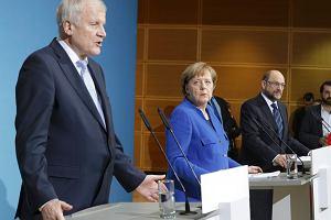 Premier Bawarii Horst Seehofer, kanclerz Angela Merkel i szef SPD Martin Schulz podczas wspólnego wystąpienia po zakończeniu rozmów w sprawie utworzenia wielkiej koalicji. Berlin, 12 stycznia 2018 r.