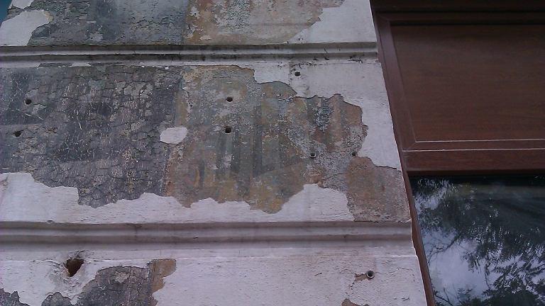 Przedwojenne reklamy na ścianach na Stalowej