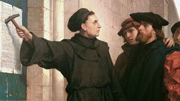 'Przybicie tez przez Lutra', obraz Ferdinanda Pauwelsa z 1872 r. Mawiano, że huk uderzeń młotka podczas przybijania tez przez augustianina niósł się przez Europę i dotarł do samego Rzymu.