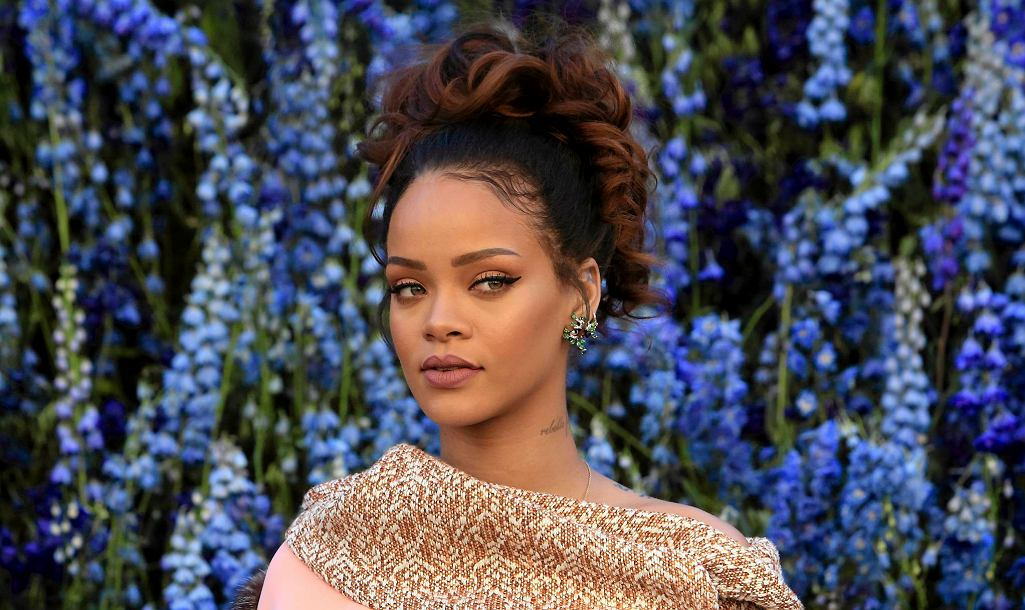 FILE - In this Friday, Oct. 2, 2015, file photo, singer Rihanna poses before Christian Dior's Spring-Summer 2016