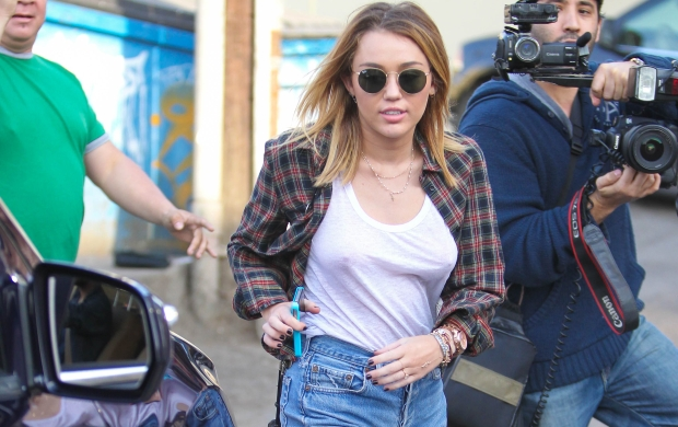 January 20, 2012 -Miley Cyrus goes braless in WeHo.Ref# AKM8391                                                                           Credit : Poersch/Spot/AKM Images.                                                                                       Contact: Alex at alex@akmimages.net                                                    Office: +1 424.237.2908 *** Local Caption ***  Miley Cyrus