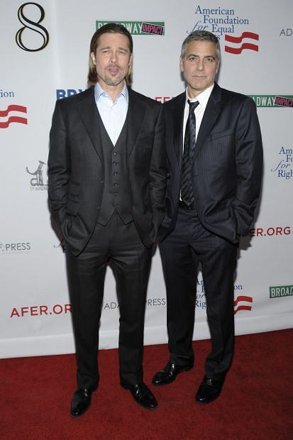 """Actor Brad Pitt, left, and actor George Clooney arrive at the Los Angeles premiere of the play """"8"""" in Los Angeles on Saturday, March 3, 2012. (AP Photo/Dan Steinberg)"""