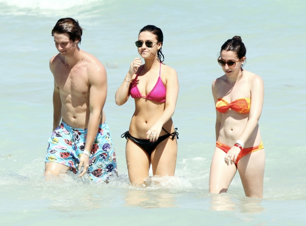 """MAVRIXONLINE.COM - Former California governor Arnold Schwarzenegger's son, Patrick Schwarzenegger was spotted showing off his beach tone body while spending time in sun with friends in Miami Beach. The 18 year old model was seen frolicking in the ocean surrounded by a couple of bikini clad ladies as well as hanging out with his guy friends. It was recently reported that Patrick was involved in a ski accident in Sun Valley which left him with a deep cut above his butt cheek. He wasn't seriously injured and tweeted a photo stating """"Little ski accident today. Some bruises and stitches down back and but [sic]. Thanks to sun valley doctors for everything."""" Miami Beach, FL. 24th March 2012.  Byline, credit, TV usage, web usage or linkback must read MAVRIXONLINE.COM.  Failure to byline correctly will incur double the agreed fee.  Tel: +1 305 542 9275."""