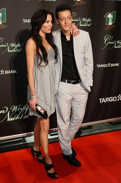 BREMEN, GERMANY - FEBRUARY 06:  Mesut Oezil and his girlfriend Anna Maria Lagerblom pose during the Werder Bremen Green White Night 2010 at the Congress Centre on February 6, 2010 in Bremen, Germany.  (Photo by Thomas Starke/Bongarts/Getty Images)