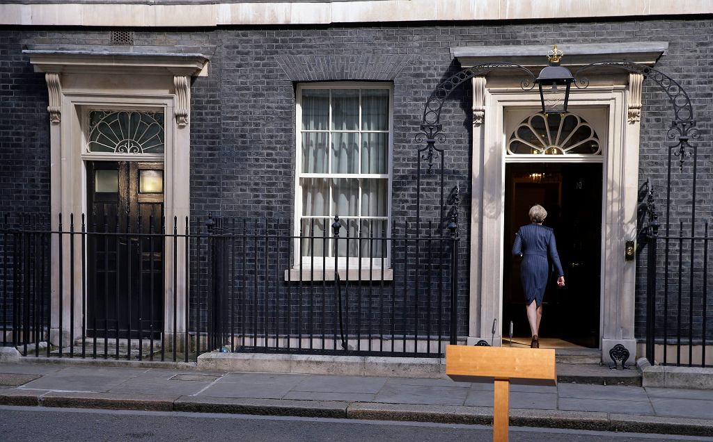 Britain's Prime Minister Theresa May walks back into her official residence of 10 Downing Street in London, after speaking to the media on Tuesday April 18, 2017. British Prime Minister Theresa May announced she will seek early election on June 8 (AP Photo/Alastair Grant)