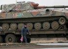 Poroszenko: Ukraina wycofała ciężki sprzęt, artyleria rebeliantów wciąż na froncie