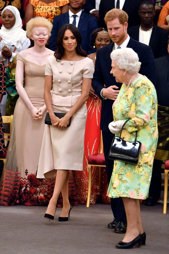Księżna Meghan, królowa Elżbieta i książę Harry na Britain Awards