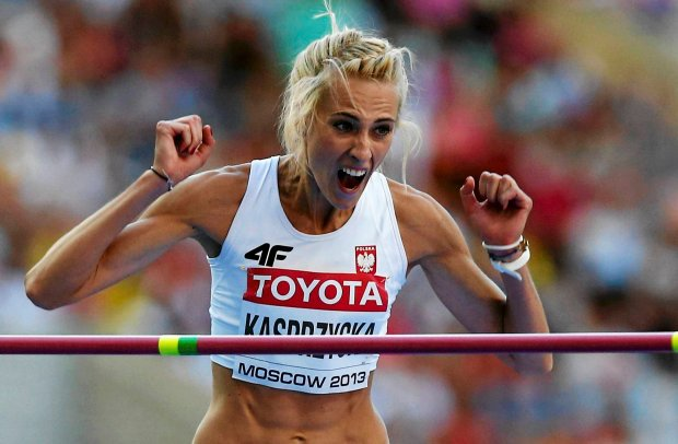 Justyna Kasprzycka of Poland reacts after successfully clearing the bar during the women's high jump final at the IAAF World Athletics Championships at the Luzhniki stadium in Moscow August 17, 2013.      REUTERS/Denis Balibouse (RUSSIA  - Tags: SPORT ATHLETICS)   SLOWA KLUCZOWE: :rel:d:bm:LR1E98H173B18