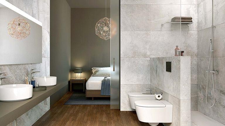 PŁYNNE PRZEJŚCIE. Drewniana podłoga to niezawodny sposób ocieplenia łazienki. Zachowując jednolitość posadzki, można też 'bezszwowo' połączyć łazienkę z sypialnią. Do spokojnego charakteru obu wnętrz pasują czyste geometryczne kształty ceramiki. Inspira Round. roca.pl
