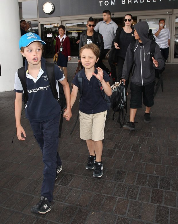 XBrad Pitt and Angelina Jolie and Family Land at LAX  Pictured: Brad Pitt, Angelina Jolie