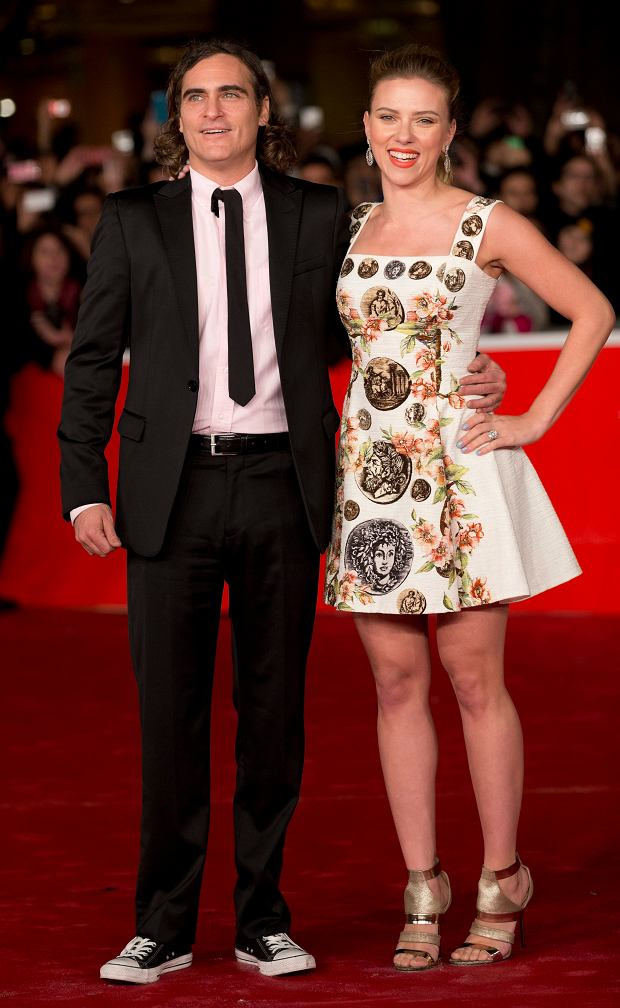 Actress Scarlett Johansson and actor Joaquin Phoenix pose on the red carpet as they arrive for the screening of the film 'Her' at the 8th edition of the Rome International Film Festival in Rome, Sunday, Nov. 10, 2013. (AP Photo/Alessandra Tarantino)