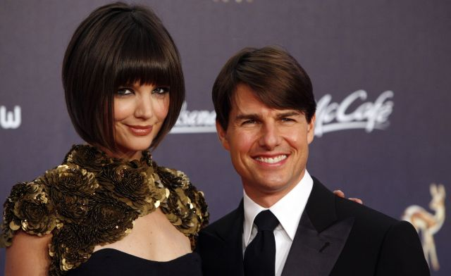 US actor Tom Cruise, right, and Katie Holmes pose for the  photographers  on the red carpet prior to the Bambi media award ceremony in Duesseldorf, western Germany, Thursday, Nov. 29, 2007. (AP Photo/Miguel Villagran)
