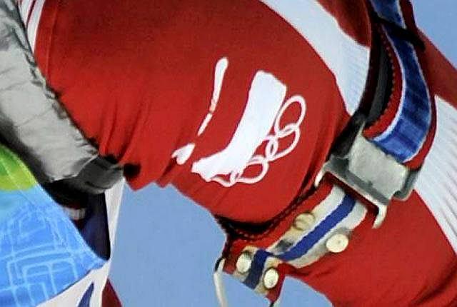 Odwrócona flaga na kombinezonie Tomasza Sikory