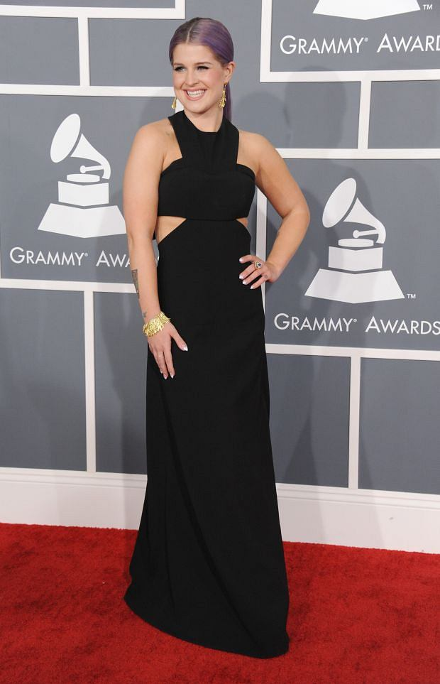 Kelly Osbourne arrives at the 55th annual Grammy Awards on Sunday, Feb. 10, 2013, in Los Angeles.  (Photo by Jordan Strauss/Invision/AP)