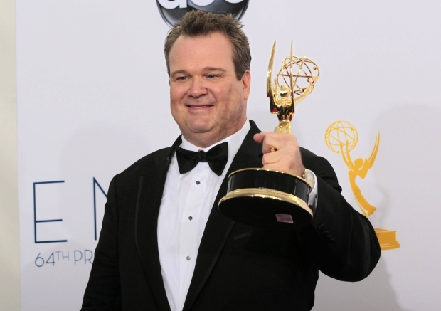 "Eric Stonestreet poses with the award for outstanding supporting actor in a comedy series for ""Modern Family"" backstage at the 64th Primetime Emmy Awards in Los Angeles, September 23, 2012.   REUTERS/Mario Anzuoni (UNITED STATES  - Tags: ENTERTAINMENT)  (EMMYS-BACKSTAGE)"