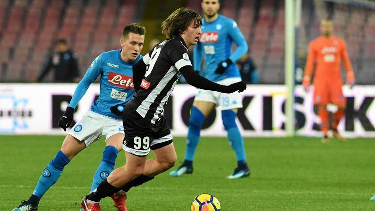 Udinese's Andrija Balic, right, and Napoli's Piotr Zielinski