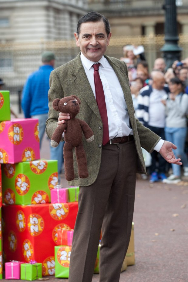 ?National News and Pictures Date: 04.09.15 PH: National News and Pictures Pictured: Mr Bean Caption: Mr Bean celebrated his 25th anniversary today with a cake outside Buckingham Palace, Central London. Mr Bean who is played by comedy actor, Rowan Atkinson, arrived on top of his famous green mini with his teddy in hand.