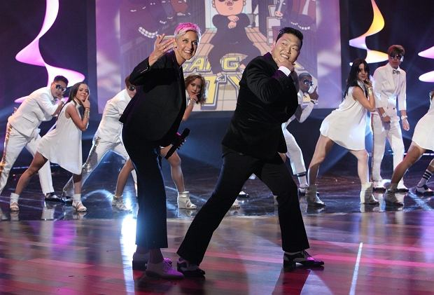 "In this photo released by Warner Bros., talk show host Ellen DeGeneres, center left, joins Korean pop star PSY as he performs his super hit ""Gangnam Style"" during a taping of ""The Ellen DeGeneres Show"" on Tuesday, Sept. 18, 2012 in Burbank, Calif.  This episode of ""The Ellen DeGeneres Show"" airs on Wednesday, Sept. 19. (AP Photo/Warner Bros., Michael Rozman) Photo Credit: Michael Rozman/Warner Bros"