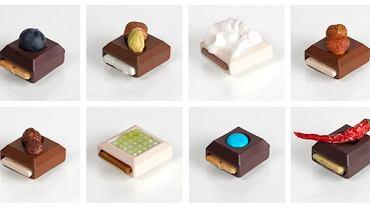 Ciemne czekoladki mają zagłębienie na owoce, mleczne - na orzechy i migdały, a te z białej czekolady - na płynne nadzienie.