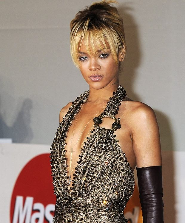 Performer Rihanna arrives for the Brit Awards 2012 at the O2 Arena in London, Tuesday, Feb. 21, 2012. (AP Photo/Jonathan Short)