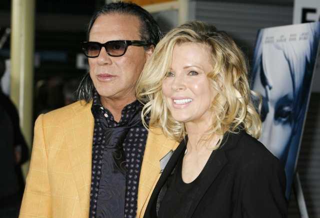 "Mickey Rourke (L) and Kim Basinger, stars of the film ""The Informers"", pose at the film's premiere in Hollywood, California April 16, 2009. REUTERS/Fred Prouser           (UNITED STATES ENTERTAINMENT)"