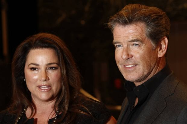 """Cast member Pierce Brosnan, right, and Keely Shaye Smith arrive at the premiere of """"The Greatest"""" in Los Angeles on Thursday, March 25, 2010. (AP Photo/Matt Sayles)"""