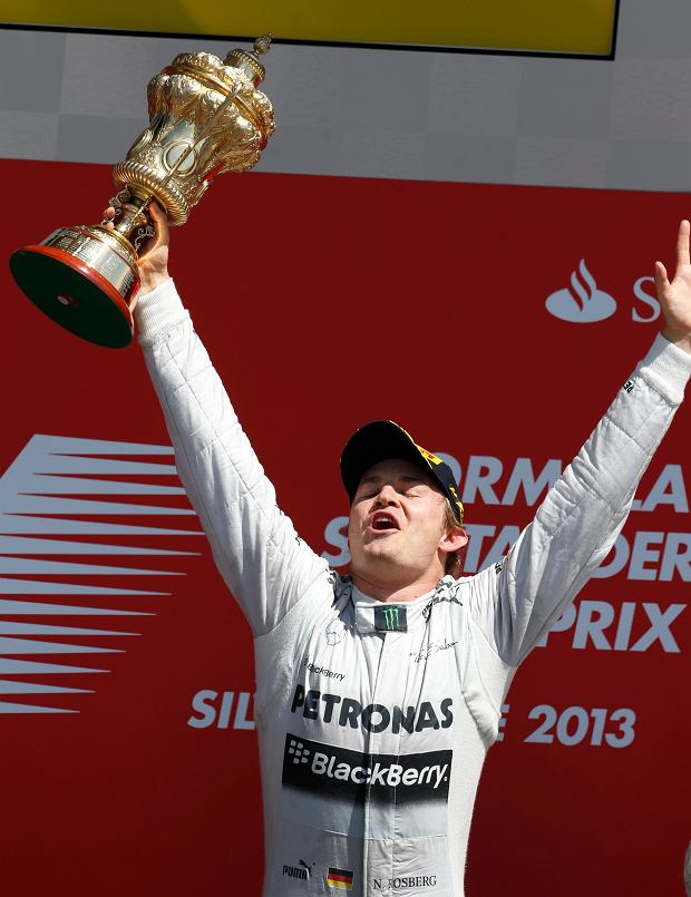 Mercedes driver Nico Rosberg of Germany celebrates after winning the Formula One British Grand Prix at the Silverstone circuit, Silverstone, England, Sunday, June 30, 2013. Red Bull driver Mark Webber of Australia finished second and Ferrari driver Fernando Alonso of Spain finished third. (AP Photo/Lefteris Pitarakis)