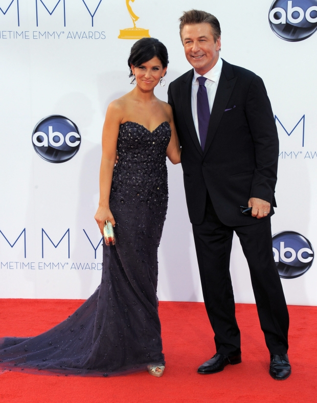 Actor Alec Baldwin, right and his wife Hilaria Thomas arrive at the 64th Primetime Emmy Awards at the Nokia Theatre on Sunday, Sept. 23, 2012, in Los Angeles.  (Photo by Jordan Strauss/Invision/AP)
