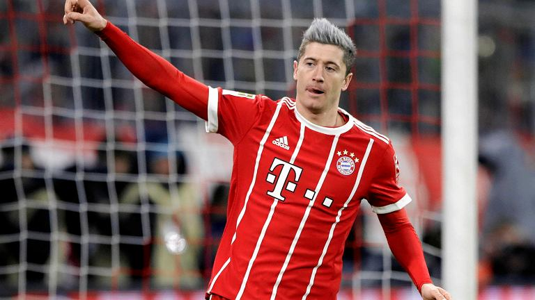 Bayern's Robert Lewandowski celebrates after scoring his side's opening goal during the German Soccer Bundesliga match between FC Bayern Munich and 1.FC Koeln in Munich