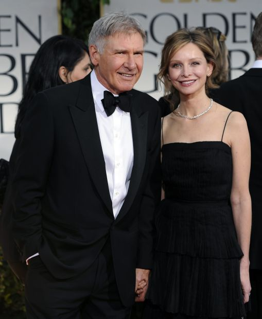 Harrison Ford, left, and Calista Flockhart arrive at the 69th Annual Golden Globe Awards Sunday, Jan. 15, 2012, in Los Angeles. (AP Photo/Chris Pizzello)