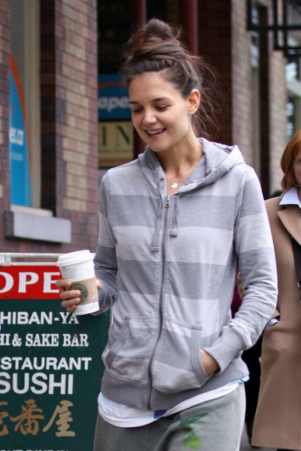 """EXCLUSIVE: Katie Holmes is spotted getting a coffee at Starbucks after a gym workout in Vancouver. Spotted without make-up the star is dressed casually in all grey, and a simple necklace with the letter """"S"""" on it.   Pictured: Katie Holmes"""