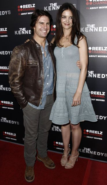 "Cast member Katie Holmes, right, and Tom Cruise arrive at the premiere of ""The Kennedys"" at The Academy of Motion Pictures Arts and Sciences in Beverly Hills, Calif. on Monday, March 28, 2011. ""The Kennedys"", an 8-part mini-series, will premiere on ReelzChannel on April 3 . (AP Photo/Matt Sayles)"